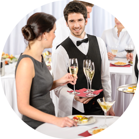 Waiter serving drink to a lady